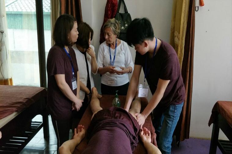 Foreign volunteer teaching Omamori Spa therapists.jpg